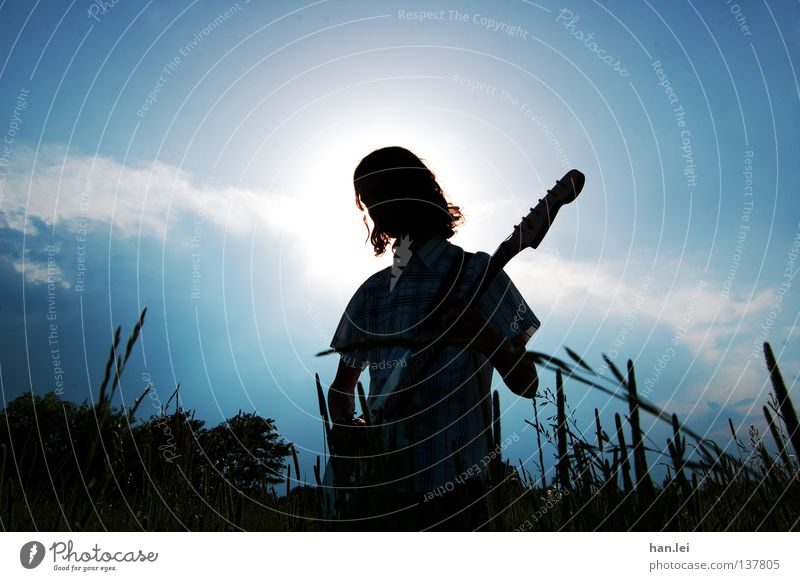 Human being Sky Man Youth (Young adults) Blue Sun Summer Adults Meadow Playing Music Lighting Field Rock music Guitar Holy