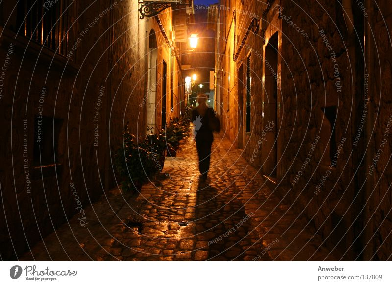 Woman at night alone on the road in Gasse in Soller, Mallorca Night In transit Alley Majorca Spain Vacation & Travel Narrow Dark Dangerous Romance Going