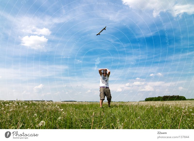 Sky Man Nature Youth (Young adults) Blue Green Summer Flower Clouds Colour Far-off places Meadow Landscape Grass Warmth Jump