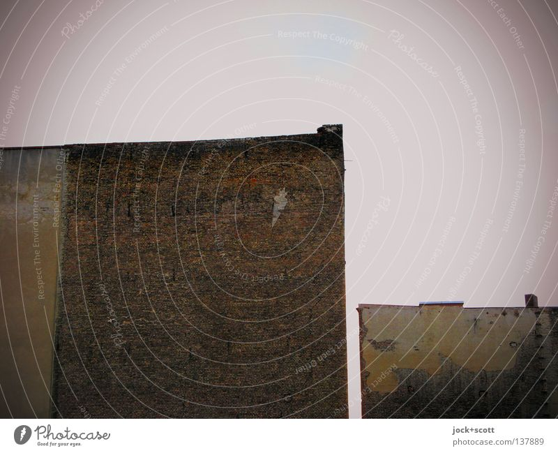 David against Goliath Sky Kreuzberg Town house (City: Block of flats) Fire wall Stone Brick Esthetic Sharp-edged Simple Large Small Gloomy Anger Brown Moody
