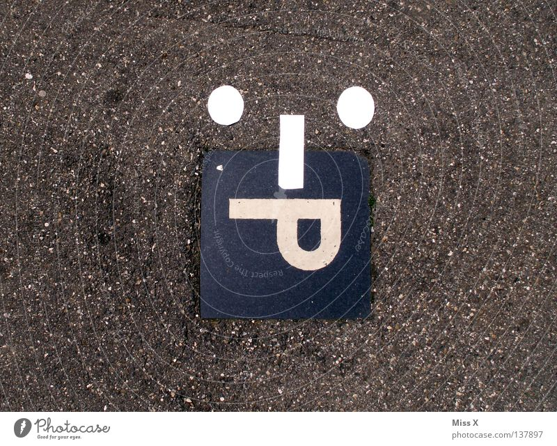 :-P Colour photo Places Street Concrete Characters Signs and labeling Funny 50 Parking lot Smiley Tar Pavement Letters (alphabet) smilies Tongue steep