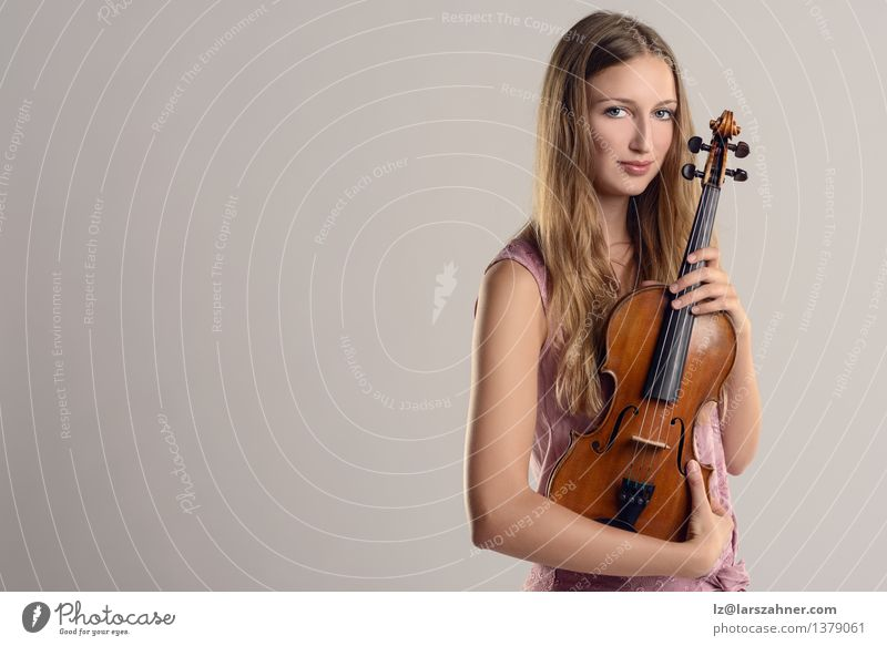 Attractive young musician holding her violin Face Leisure and hobbies Entertainment Music Academic studies Profession Girl Woman Adults Youth (Young adults) 1