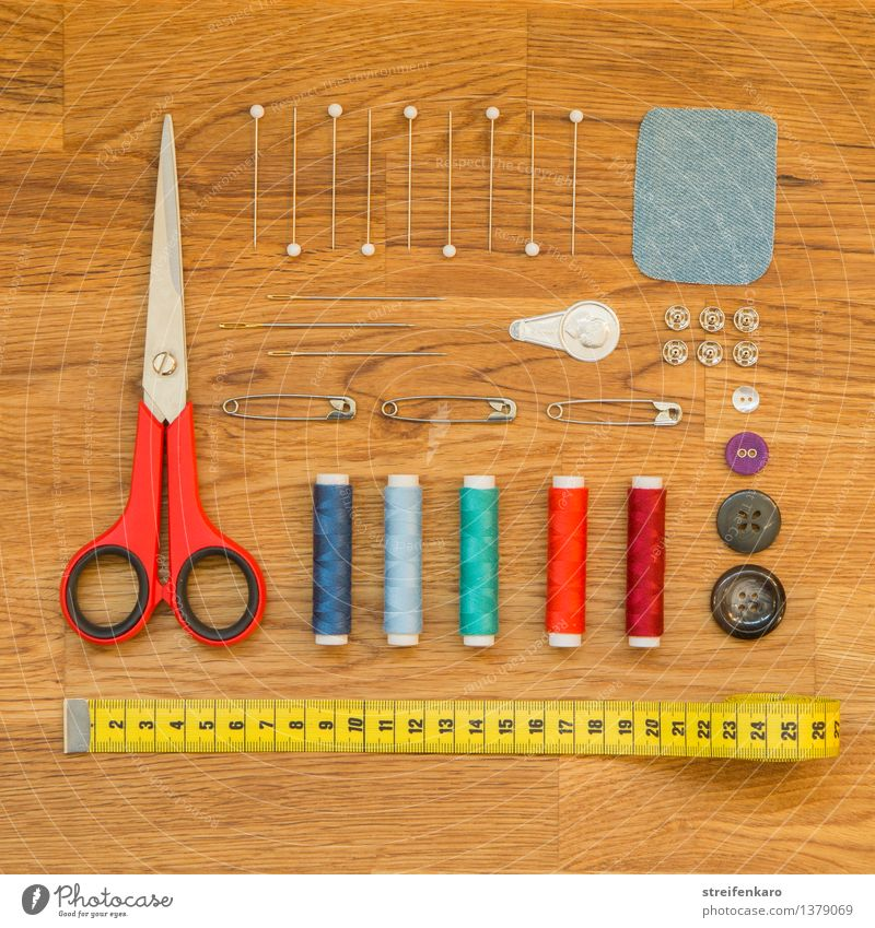 sewing utensils, neatly arranged on a wooden table Design Leisure and hobbies Handcrafts Work and employment Profession Tailor Workplace Services Craft (trade)