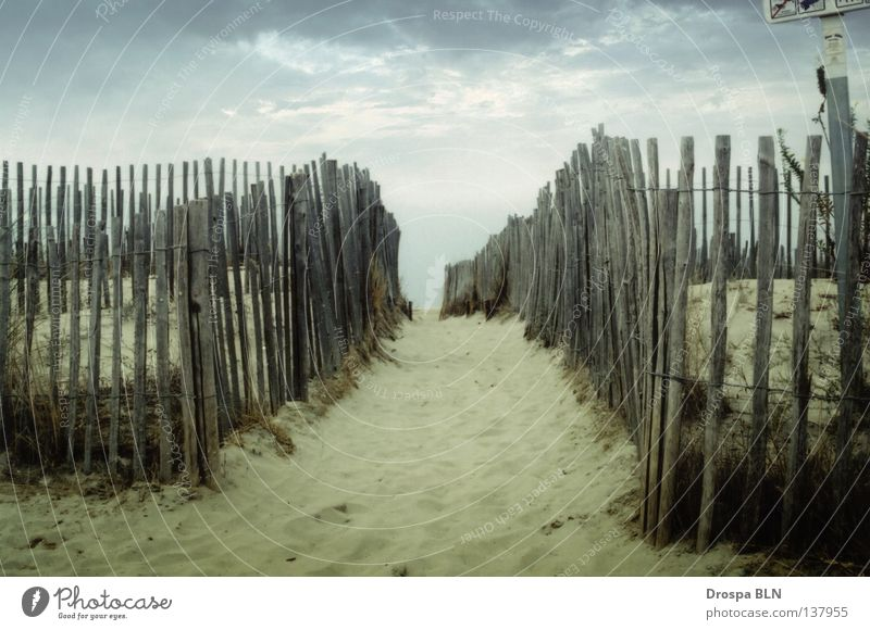 A fence in France Beach South Vacation & Travel Fence Clouds Narrow Sand Cover Lanes & trails holiday