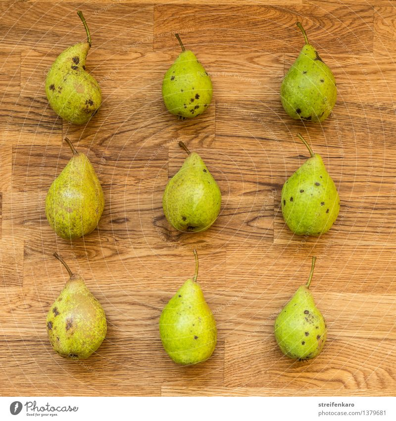 Nine pears, regularly arranged on a wooden table Food Fruit Pear Nutrition Eating Organic produce Vegetarian diet Diet Slow food Healthy Kitchen Thanksgiving
