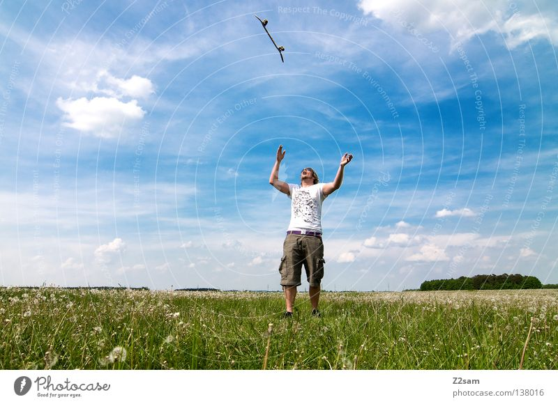 Gift of heaven Gravity Contentment Jump Skateboarding Sports equipment Youth culture Action Grass Green Light blue Masculine Sky Summer Sunday Style Meadow