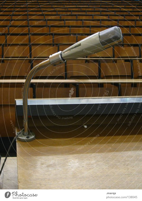 speech Speech Lecture hall Audimax Academic studies Microphone Gray Brown Table Chair Row of seats Wooden bench Grid Seating capacity Incline Black Expectation