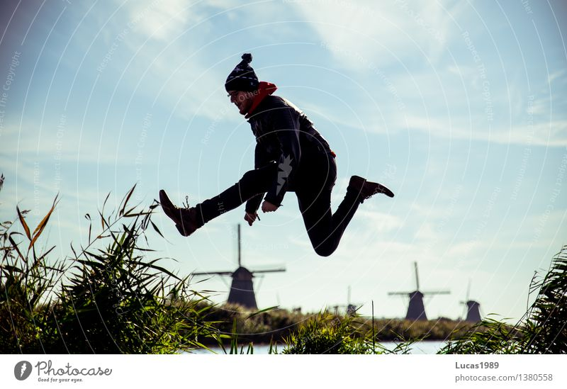 Higher than the windmills Human being Masculine Young man Youth (Young adults) Man Adults 1 18 - 30 years 30 - 45 years Environment Nature Grass Bushes