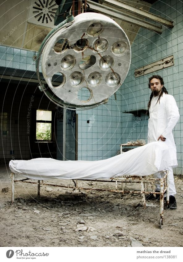 DR. THREE Doctor Cutlery White Apron Dreadlocks Operation Hair and hairstyles Derelict War Destruction Trash Building rubble Plaster Broken Short Small Patient