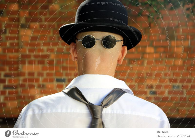 rear is front Lifestyle Masculine Shirt Tie Eyeglasses Sunglasses Hat Bald or shaved head Cool (slang) Style Wall (barrier) Identity Unidentified Mask Derby