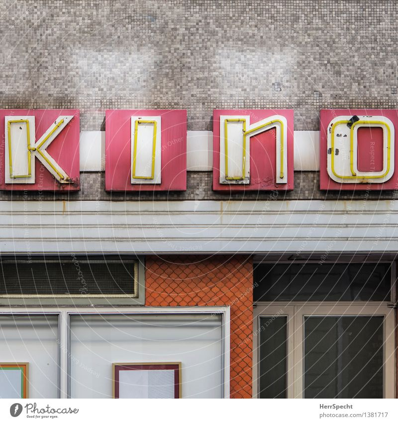 old fashioned Vienna Downtown Old town Manmade structures Building Facade Characters Signs and labeling Esthetic Gloomy Town Cinema Neon sign Tradition