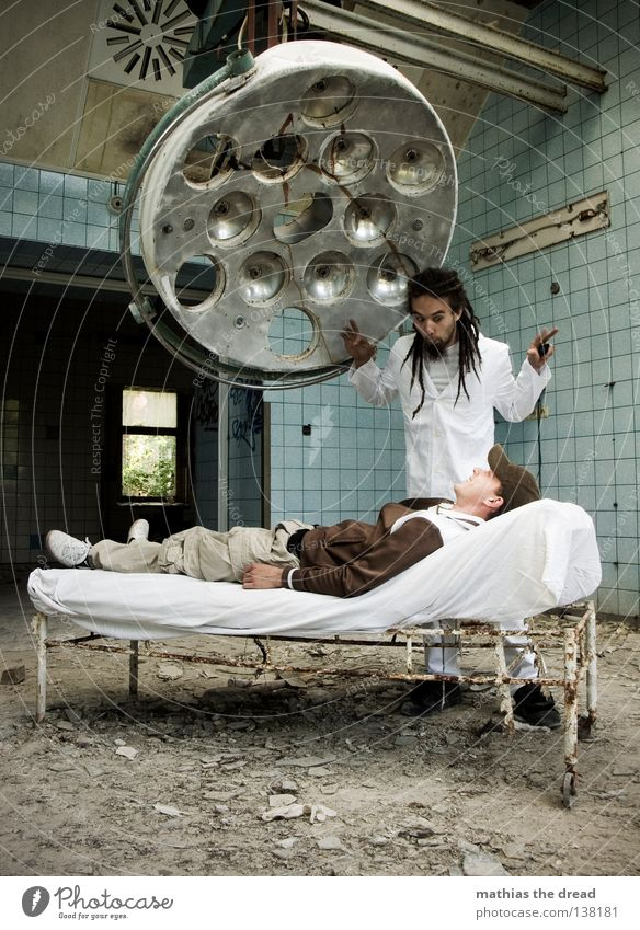WHAT A BEAUTIFUL PLACE WE HAVE HERE! Doctor Cutlery Tool White Apron Dreadlocks Operation Hair and hairstyles Derelict War Destruction Trash Building rubble