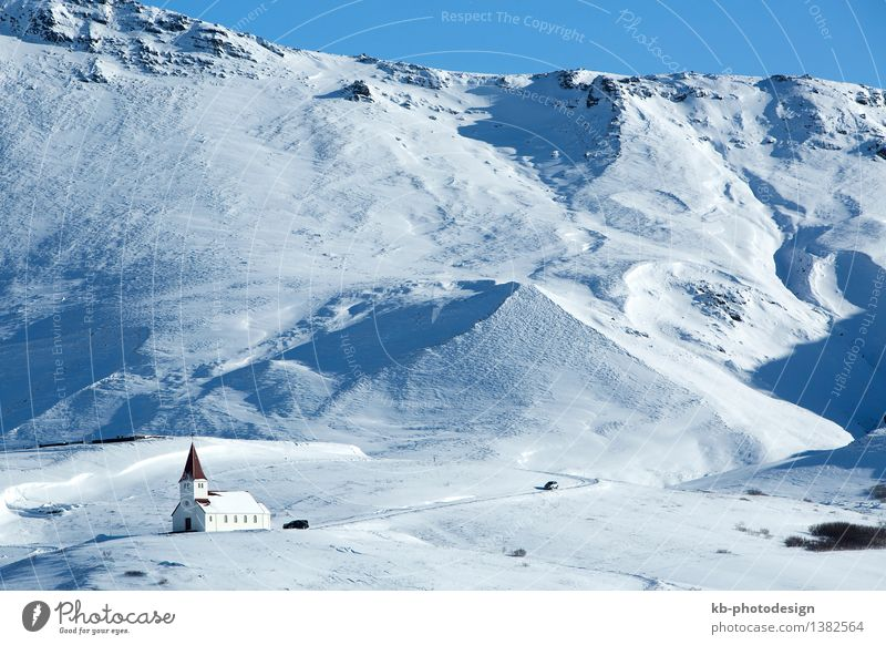 Church of Vik in wintertime with snowy mountains, Iceland Vacation & Travel Tourism Adventure Far-off places Winter Winter vacation Mountain Small Town