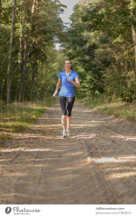 Athletic woman out jogging in a forest Human being Woman Nature Youth (Young adults) Loneliness Landscape Girl 18 - 30 years Forest Adults Sports Lifestyle Sand Body Action Fitness