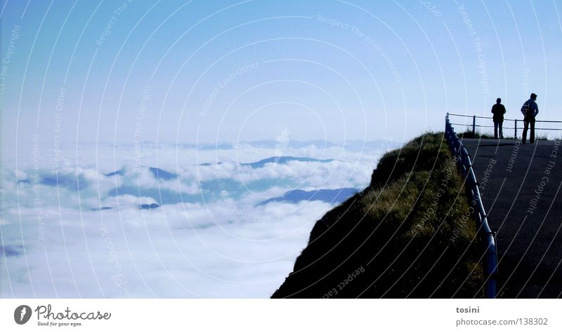 Human being Sky Blue Clouds Street Grass Mountain Air Horizon Vantage point Infinity Handrail Edge Valley Slope Platform