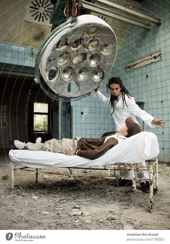 hypnosis Doctor Cutlery Tool White Apron Dreadlocks Operation Hair and hairstyles Derelict War Destruction Trash Building rubble Plaster Broken Short Small
