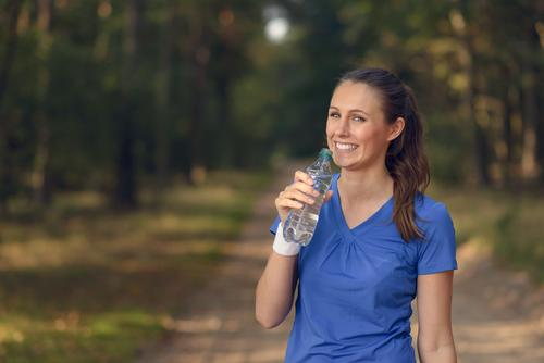 Fit young woman drinking bottled water Human being Woman Nature Youth (Young adults) Summer Girl Forest Face Adults Sports Laughter Happy Lifestyle Fresh Body