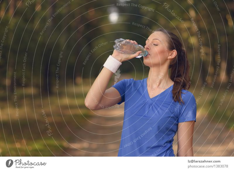 Fit young woman drinking bottled water Beverage Drinking Lifestyle Happy Body Face Wellness Summer Sports Girl Woman Adults 1 Human being 13 - 18 years