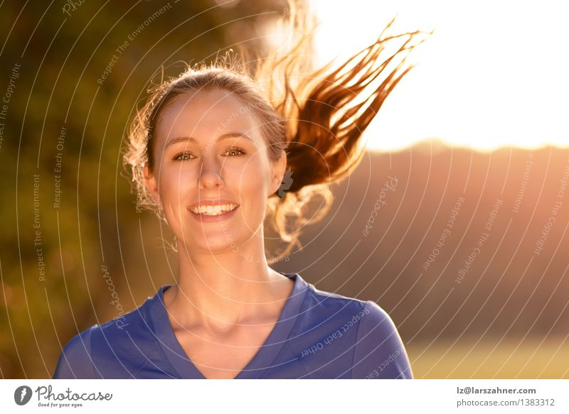 Attractive woman out exercising in glowing light Human being Woman Nature Youth (Young adults) Blue Beautiful Summer Landscape Girl 18 - 30 years Face Adults Warmth Autumn Sports Happy