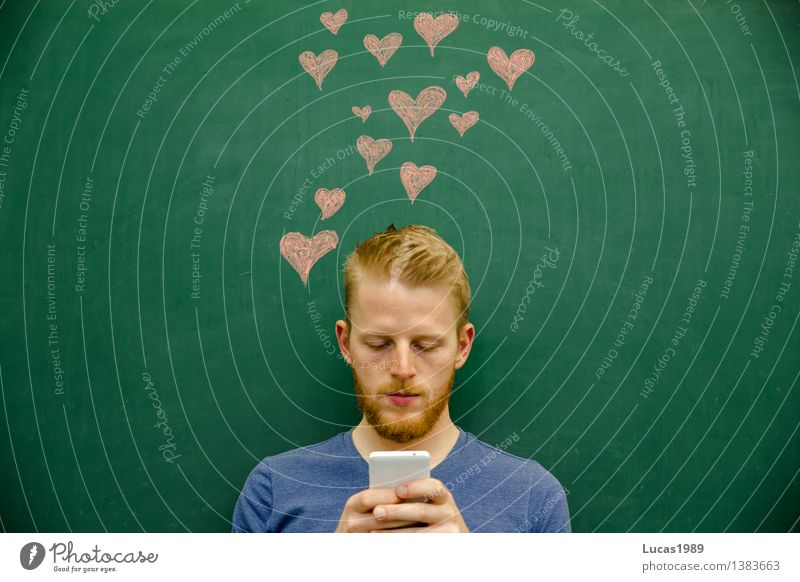 young man writes message uses mobile phone hearts School Blackboard Academic studies Study University & College student Chalk PDA SMS Information Human being