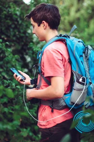 Boy charging mobile phone during the journey Human being Vacation & Travel Youth (Young adults) Summer Boy (child) Hiking 13 - 18 years Trip Adventure
