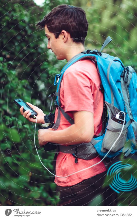 Boy charging mobile phone during the journey Vacation & Travel Trip Adventure Summer Summer vacation Hiking Financial institution Cellphone Boy (child)