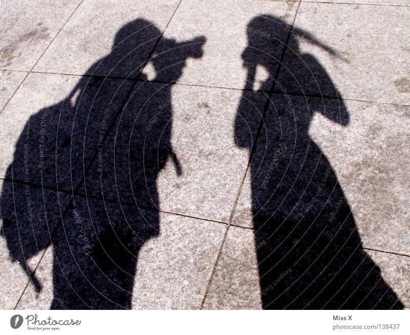 paparazzi Colour photo Black & white photo Exterior shot Shadow Silhouette Human being Woman Adults Man Legs Traffic infrastructure Street Gray Asphalt Stony