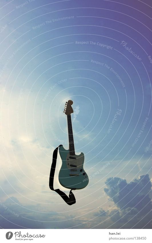 air guitar Far-off places Freedom Music Guitar Air Sky Clouds Flying Throw Blue Violet Electric guitar Musical instrument string Rock'n'Roll Song Tone