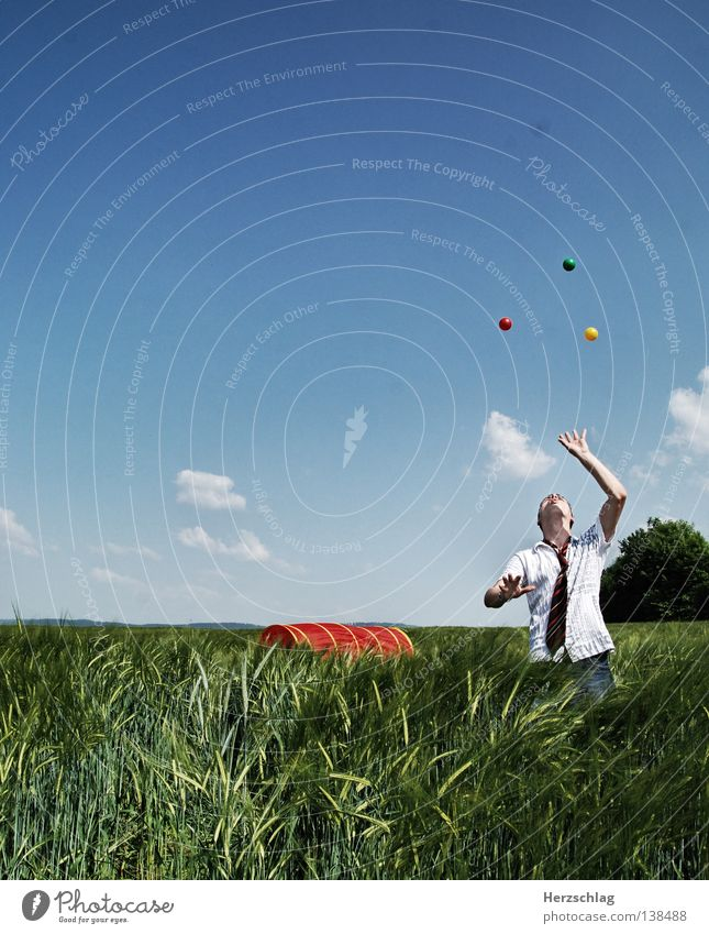 Juggles Red Yellow Green Round Hand Tie Field Clouds Summer Ball Blue Joy Colour Sphere Sky Electricity Clown