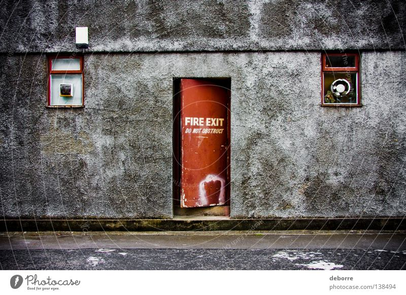 FIRE EXIT - Do Not Obstruct ! Blaze Way out Wall (building) Red Gray Alley Derelict Warning label Warning sign exit door grey Street backalley Shabby gritty
