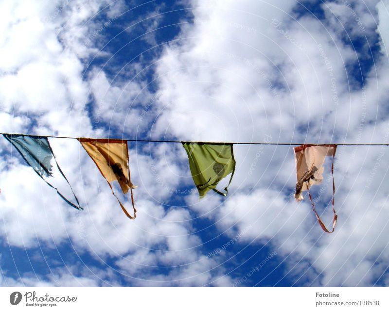 Pennant on a leash in front of a blue sky with many thick clouds Colour photo Multicoloured Exterior shot Deserted Copy Space top Copy Space bottom Day