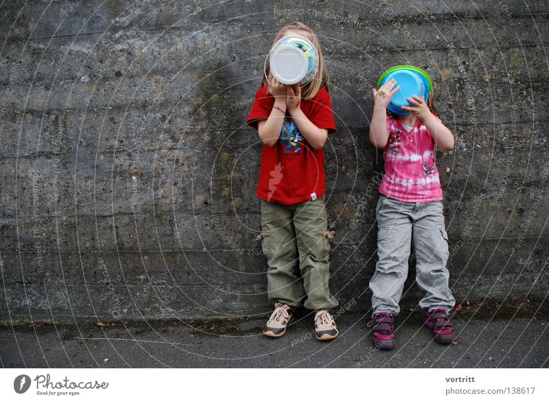 Child Blue White Red Girl Family & Relations Street Wall (building) Playing Gray Sand Wall (barrier) 2 Together Pink Concrete