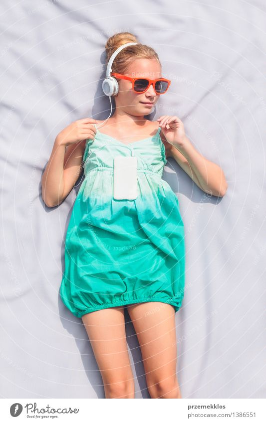 Girl listening to music from mobile phone Lifestyle Relaxation Leisure and hobbies Summer Music Child Telephone Human being 1 8 - 13 years Infancy Dress