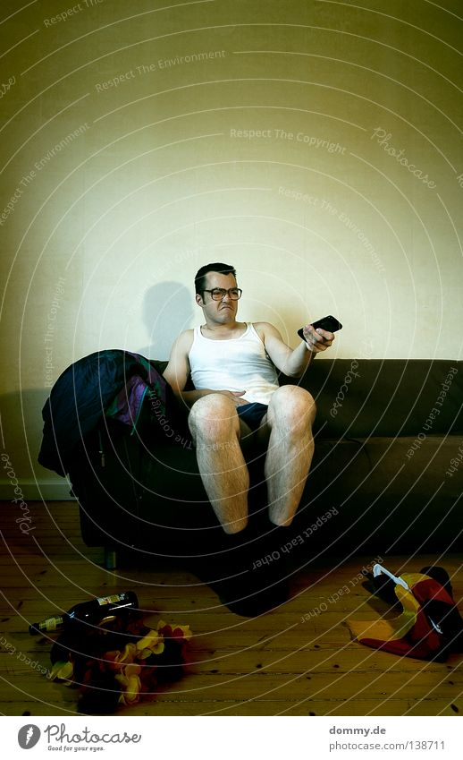 after the game... Beer Bottle Sofa Man Adults Legs Television Watching TV Eyeglasses Flag Disgust Boredom Fellow Remote control Undershirt horn-rimmed glasses