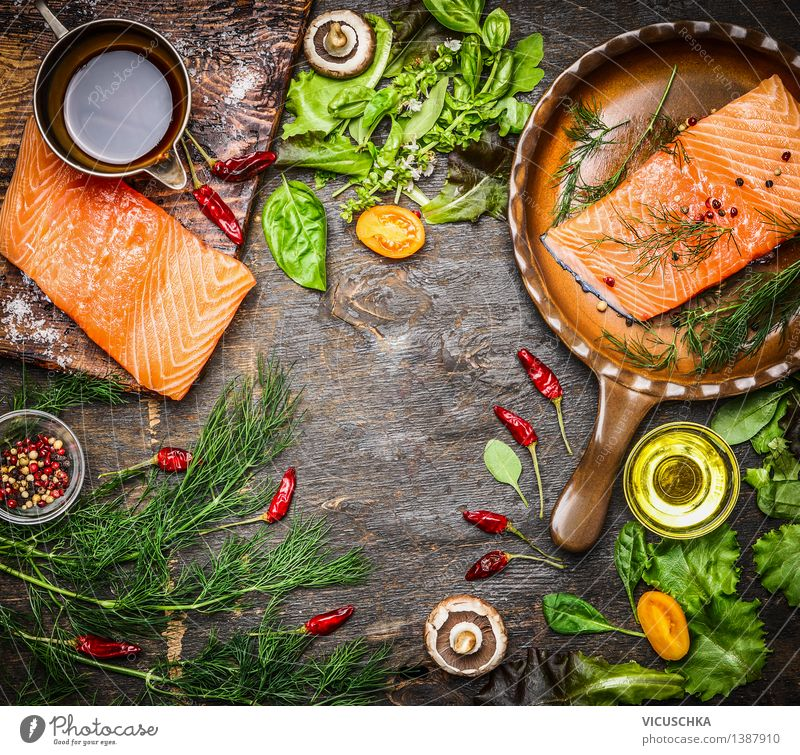 Salmon fillet on a rustic kitchen table with fresh ingredients Food Fish Vegetable Lettuce Salad Herbs and spices Cooking oil Nutrition Lunch Dinner Banquet