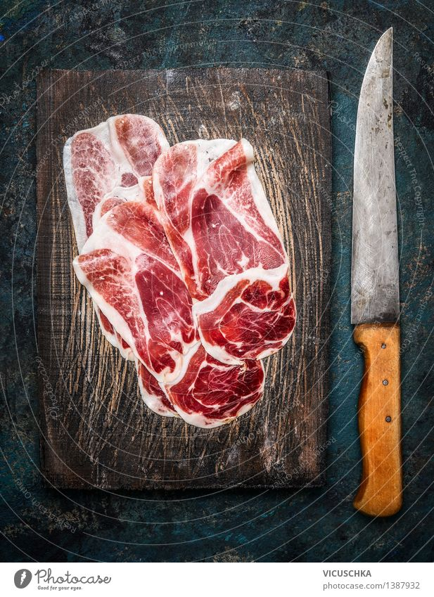 Slices of Iberico ham Cebo with kitchen knife Food Meat Sausage Nutrition Lunch Buffet Brunch Banquet Knives Style Design Table Kitchen Restaurant Bar