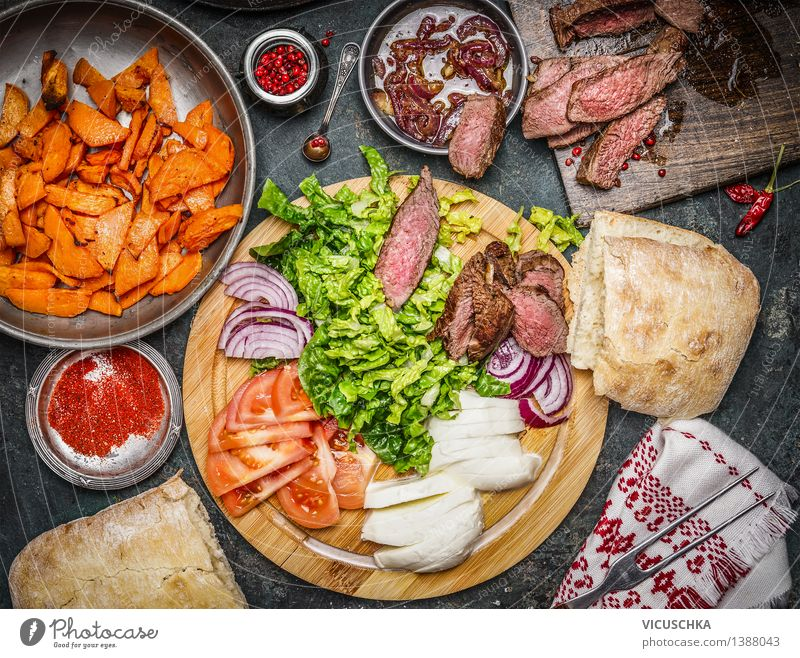 Ingredients for sandwich with medium fried steak. Food Meat Vegetable Lettuce Salad Herbs and spices Cooking oil Nutrition Lunch Dinner Buffet Brunch