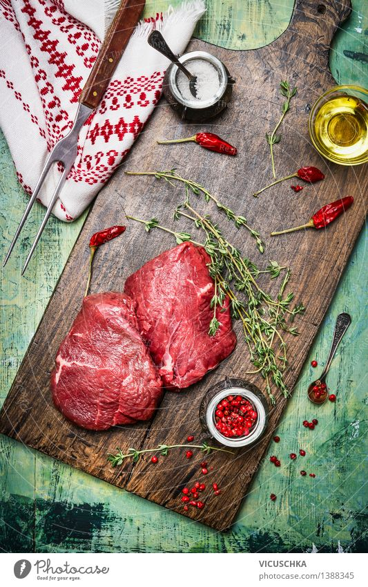 Hip steaks on with oil, herbs and spices Food Meat Herbs and spices Cooking oil Nutrition Lunch Dinner Banquet Organic produce Diet Bowl Fork Style Design