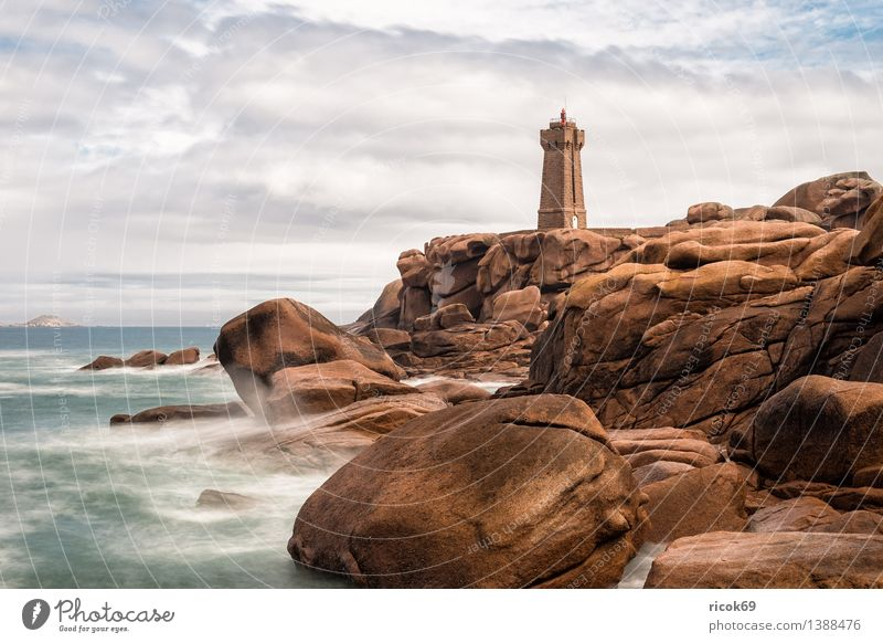 Atlantic coast in Brittany Relaxation Vacation & Travel Nature Landscape Clouds Rock Coast Ocean Lighthouse Building Architecture Tourist Attraction Stone