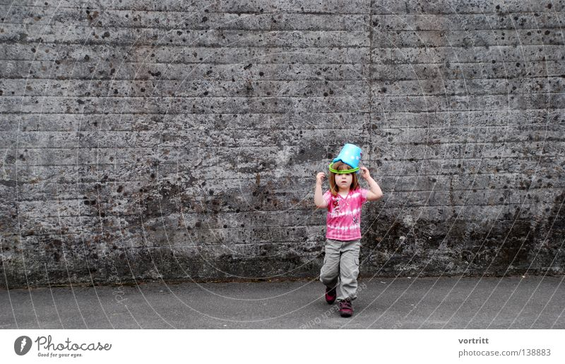 Human being Child Girl Beautiful Summer Joy Loneliness Wall (building) Playing Gray Head Lanes & trails Sand Small Going Walking