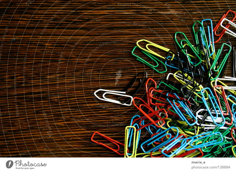 klammerkrams l Paper clip Chaos Muddled Multicoloured Wood Yellow White Reddish black Green Flexible Wire Attachment paperclip chaos Wood grain