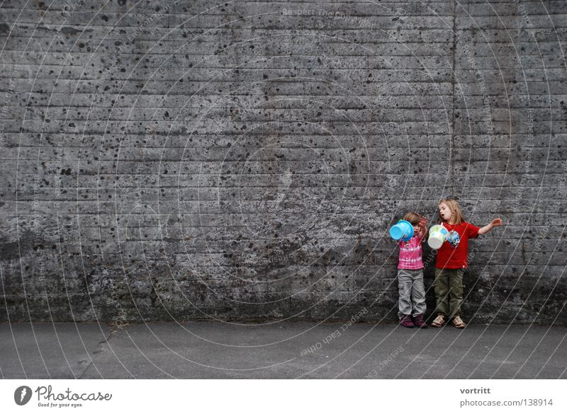 Human being Child Girl Beautiful Summer Joy To talk Wall (building) Playing Gray Sand Small Concrete Free Stand Authentic