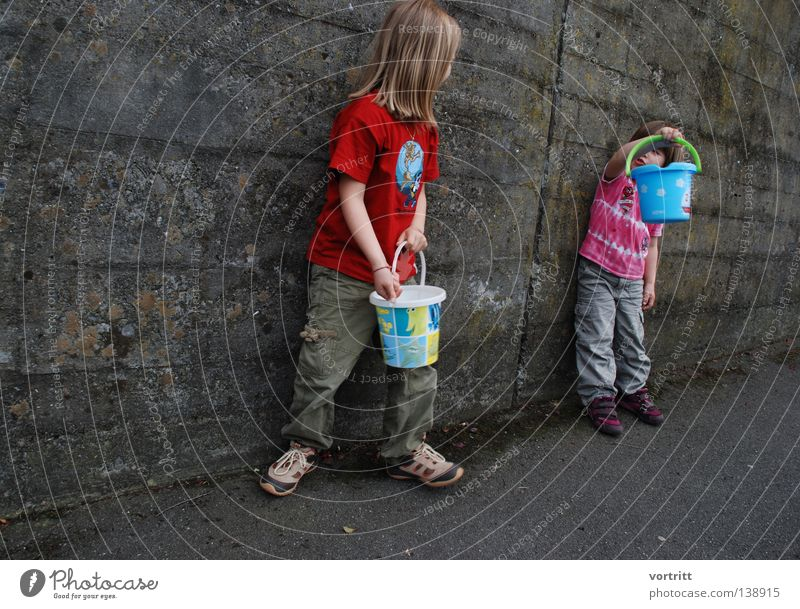 Human being Child Girl Beautiful Summer Joy To talk Wall (building) Playing Above Gray Sand Together Small Concrete Free