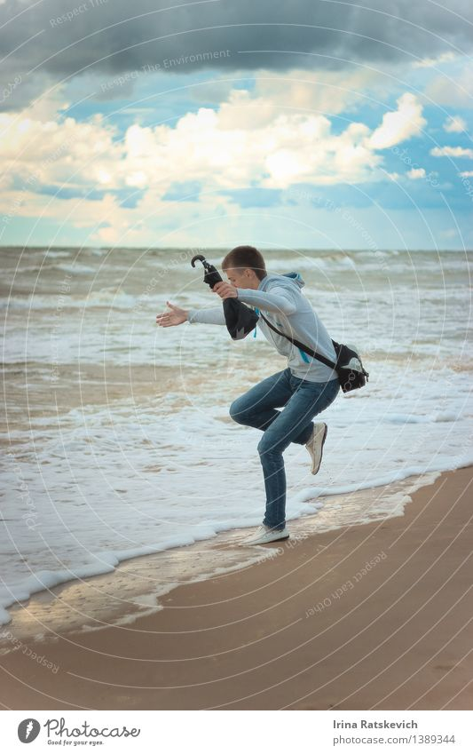 boy jumping at the Sea. Human being Sky Nature Youth (Young adults) Beautiful Summer Sun Ocean Young man Landscape Clouds 18 - 30 years Adults Emotions Fashion
