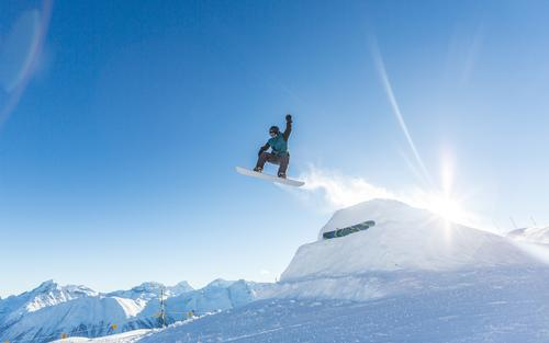 Human being Sun Landscape Winter Cold Mountain Snow Sports Flying Bright Jump Masculine Ice Tall Speed Beautiful weather