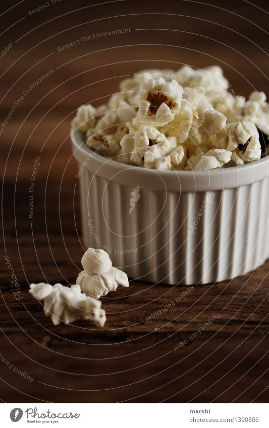 Popcorn to go Food Dessert Candy Nutrition Eating Moody Maize puffed Bowl Dark Snack Cinema Delicious Sweet Salty Sugar Colour photo Interior shot Studio shot