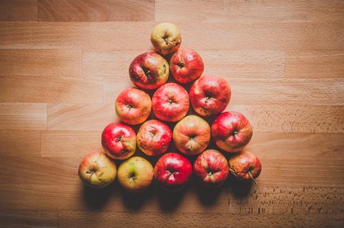 Warning triangle of apples on wooden table Food fruit Nutrition Eating Breakfast Picnic Organic produce Vegetarian diet Diet Fasting Slow food Juicy Brown