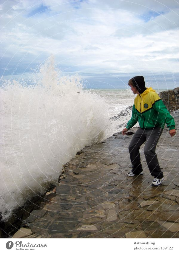 anxiety Ocean Waves Human being Man Adults Nature Water Sky Clouds Weather Rain Rock Jacket Stone Movement Stand Yellow Green Fear Respect Surf