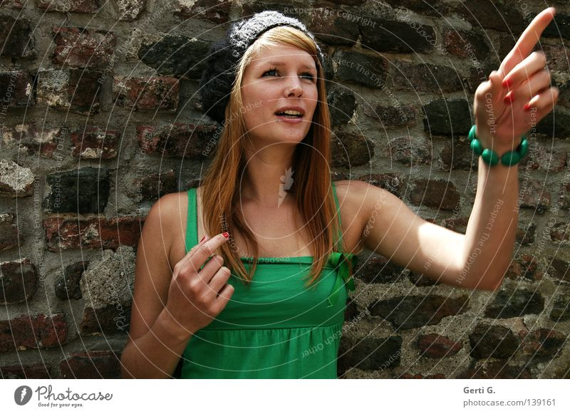 Woman Nature Hand Beautiful Green Wall (building) Emotions Wall (barrier) Fingers T-shirt Direction Cap Facial expression Surprise Long-haired Red-haired