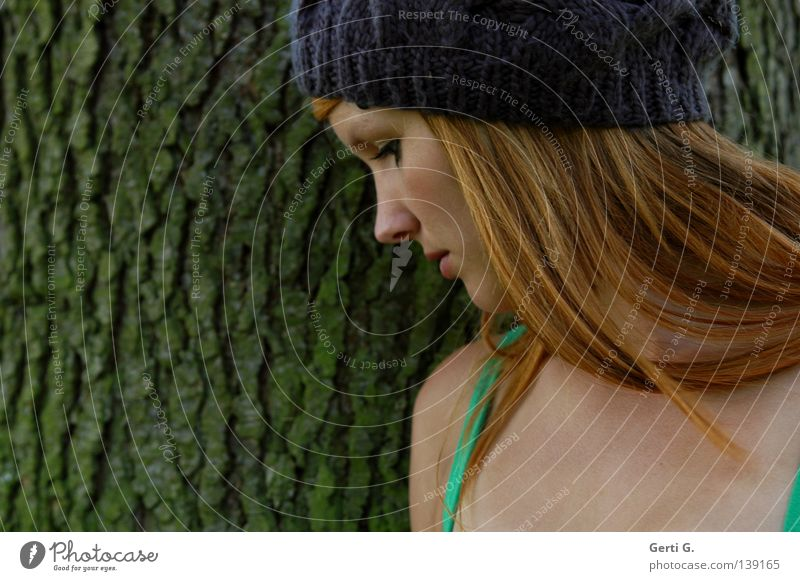 cap girl Tree bark Furrow Woman Young woman Calm Think Neutral Beautiful Long-haired Red-haired Cap Portrait photograph Silhouette Profile Side Trust Nature